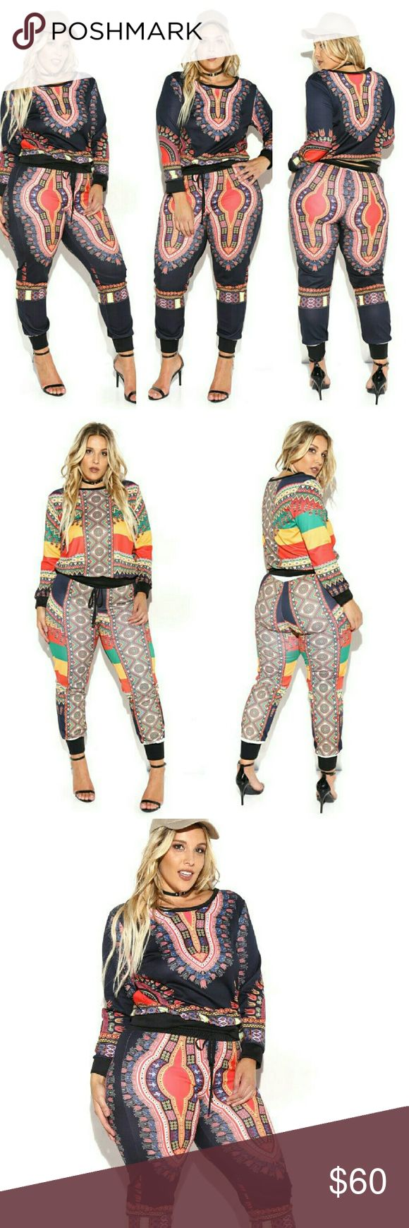 Dashiki Print Sweatshirt & Sweatpants Set A set that includes a sweatshirt with a boat neckline and long sleeves. Includes a pair of sweatpants with a drawstring waist. Dashiki print on both items.  - 95% Polyester 5% Spandex  - Hand Wash Cold ComeCorrect  Pants Track Pants & Joggers