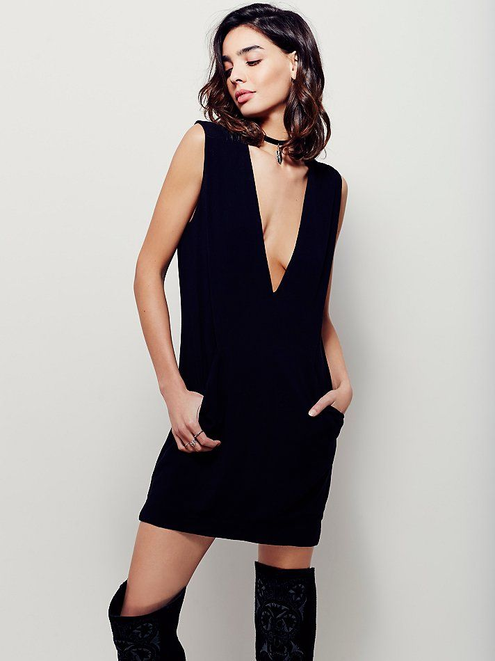 Lisa Dress | Chic, minimal dress featuring a deep V-neckline and shapeless silhouette. Front on-seam pockets and subtle gathered stitching for a modern look. Fully lined.