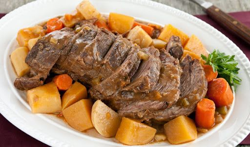 Pot Roast, Such As Blade, Chuck, Or Cross Rib Pot Roast With Pot Roast, Salt, Freshly Ground Pepper, Olive Oil, Onions, Carrots, Celery Ribs, Garlic Cloves, Thyme, Flour, Tomato Paste, Beef Stock, Worcestershire Sauce, Brown Sugar, Bay Leaves, Salt, Freshly Ground Pepper, Carrots, Turnips, Parsnips, Rutabaga, Chopped Parsley, Green Beans, Extra-virgin Olive Oil, Salt, Freshly Ground Pepper