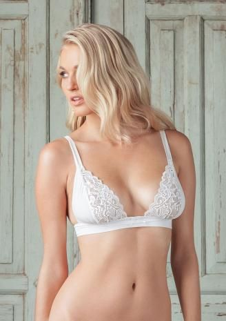 This soft cup bra curves beguilingly around the breasts, highlighting pretty lace scallops. Balanced with lace and crepe chiffon panels that are slightly gathered into a soft midriff pleated band, the bra is an irresistible mix of pretty and provocative.