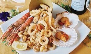 Groupon - Menu tradizionale di pesce o carne con bottiglia di vino per 2 o 4 persone all'Hostaria Ostia (sconto fino a 59%) a Ostia. Prezzo Groupon: €44,90