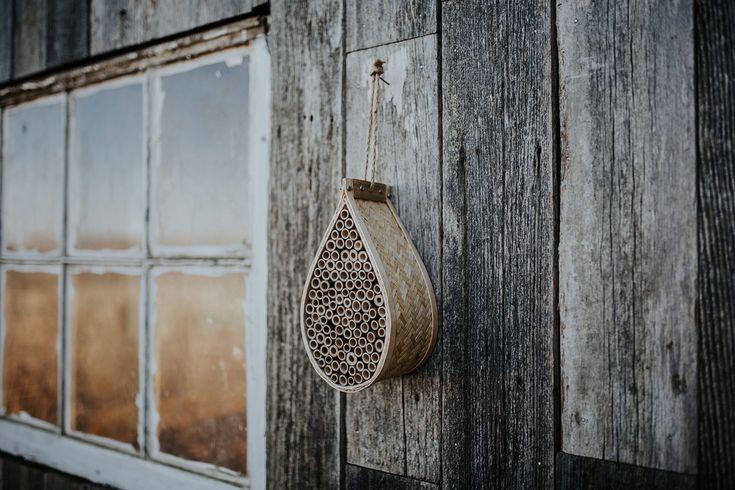 Bamboo mason bee house with dozens of natural bamboo