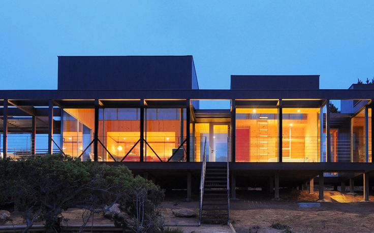 Nicolas loi arquitectos fachada madera pino exterior casa moderna vista playa tunquen rodriguez harvey