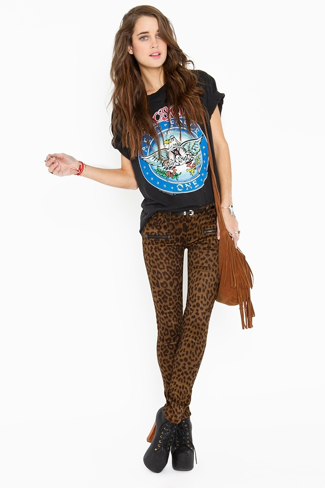 Leo Zip Pants -I love these leopard print pants,  I really want a pair but they only look good on skinny girls. boo. On a side note, I own that vintage Aerosmith shirt she is wearing and I just bought a purse just like that one. Very cool outfit.