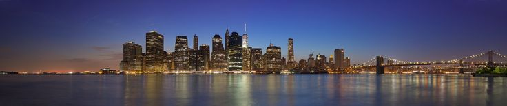 Blue hour panorama of the iconic view on Lower Manhattan from Brooklyn Bridge Park [OC] [2048x435]
