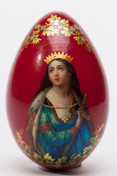 A Russian papier-mache lacquer Easter egg decorated with image of Saint Katherine on red ground, Marked with manufacturer's stamp of Lukutin, circa 1890 on the inside. SIZE: 4 in.