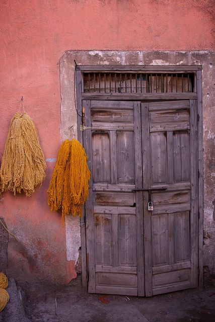 """Africa Marrakech Door in the Dyers Souk © Marcus Beard""  I love this image, the worn door, the wall and the drying dyed yarns. The colours and composition too. S"