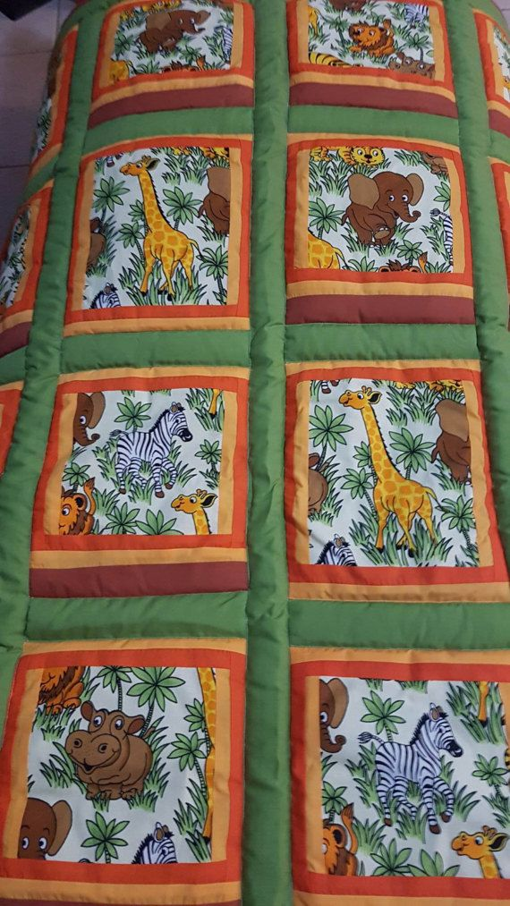Perfect for your little ones that adore wild animals, 16 fussy cut blocks Zebra, Lions, giraffe, Hippos adorn this 16 square patchwork quilt. Ideal for cot or toddler bed Quilt measures 86 cm wide by 97 cm long. Beautiful earthy tones with a olive green backing Quilt cotton and polyester batting Polyester wadding is perfect for little ones with allergies.  Completely washable in machine in cold water and hang dry. No bleach or bleach like products At Mean Mothers Creations we can create a…