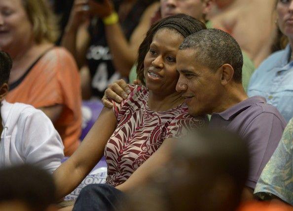 Michelle Obama Photos Photos - U.S. President Barack Obama and first lady Michelle Obama attend a basketball game coached by the first lady's brother, Oregon State University Head Coach Craig Robinson, against the University of Hawaii at Manoa Stan Sheriff Center on December 22, 2013 in Honolulu, Hawaii. The president and his family spend the Christmas holiday in Hawaii, Obama's birthplace. - President Obama Arrives For Holiday Vacation In Hawaii