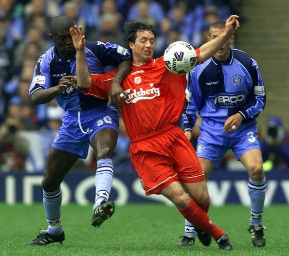 Liverpool striker Robbie Fowler battles with Wycombe Wanderers' defender Steve Brown 08 April 2001 during their FA Cup semifinal match at Villa Park...