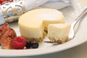 New York Baked Cheesecake:   Thick cream cheese blended with smooth Crème Fraîche, baked to perfection on a thin shortbread crumb base.