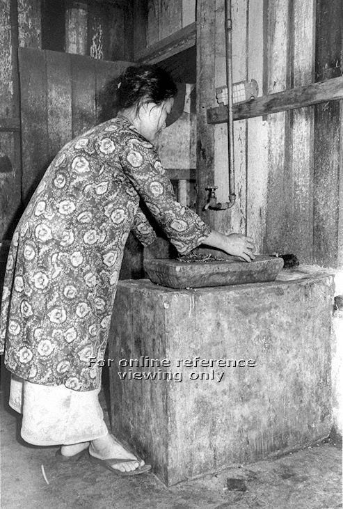 Malay woman grinding spices - 1970. Source: NAS