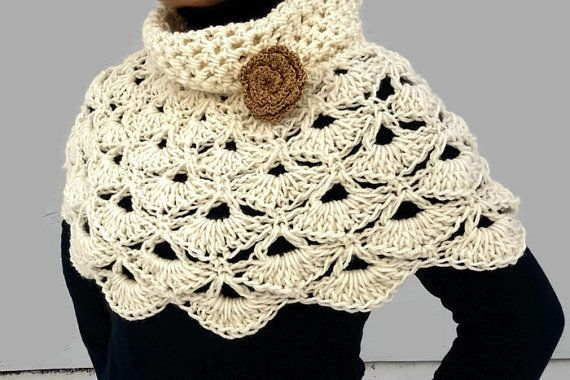 This Capelet Poncho, is hand crocheted in a super soft acrylic yarn. This Capelet has a beautiful flower brooch and you can use it with or without the flower. You can also use the flower pin on your favorite clothes. This Crochet Capelet will look beautiful with jeans, a lovely dress or even on a jacket.  Size : Length from top to bottom : 15 in ( 38 cms ) The Capelet stretches a little bit as most of crochet items (The measure was taken with the item laying flat ) The size is unique and…