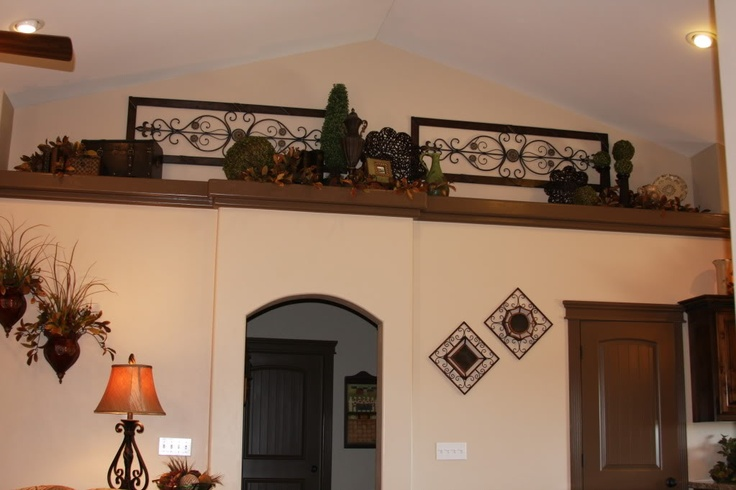 plant shelf ideas. Mostly I like the pieces on the wall behind the decorations.