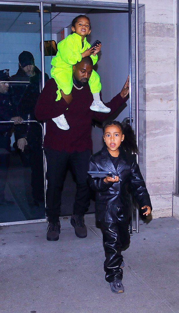 Saint West 4 Rocks Bright Neon Green Outfit While Riding On Dad Kanyes Shoulders Cute Pics Kanye West Is Such A Kardashian Kids Saint West Neon Green Outfits