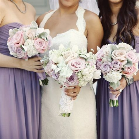 For a soft, vintage feel, try pale purple, pink and off-white bouquets of hydrangeas, roses, and dusty miller