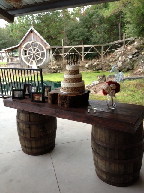 Whiskey Barrels And Wood Plank As Wedding Cake Table Wood