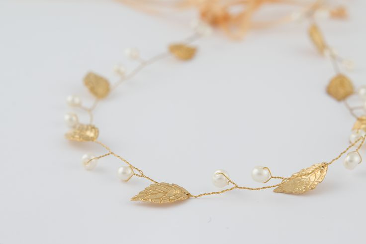 Little Lace Leaves hair vine in a unique design gold dipped leaves and glass pearls. This stunning hair piece has a detachable ribbon. Can be worn as a hair vine in various styles and also as a hairband style or sash/belt.