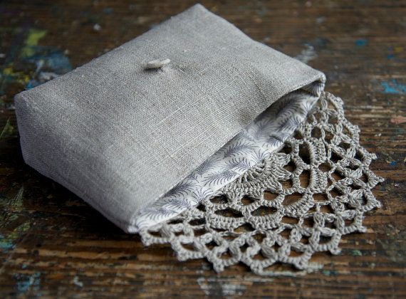 This elegant pouch/clutch is made of pure linen and closes with hand crocheted doily detail and linen covered button. Lined with cotton fabric. Approx.