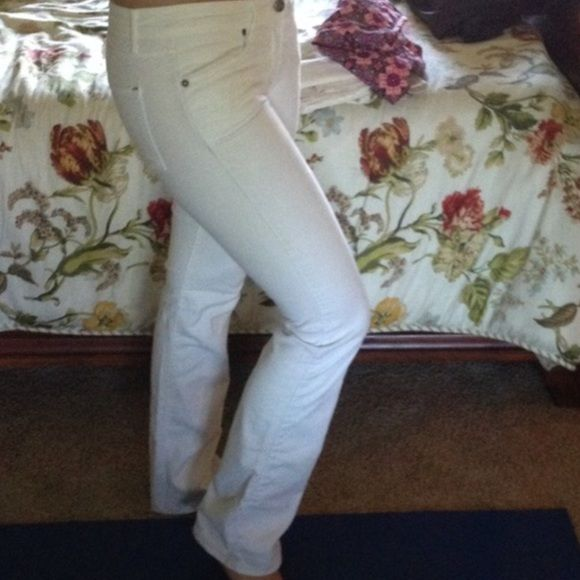 Rich & Skinny White Bootcut Jeans Size 29 white Bootcut jeans from Rich and Skinny. They were purchased from poshmark and they are too big on me. There is a small hole in the pocket as seen in the picture but has no affect on the wear of the jeans. Rich & Skinny Pants
