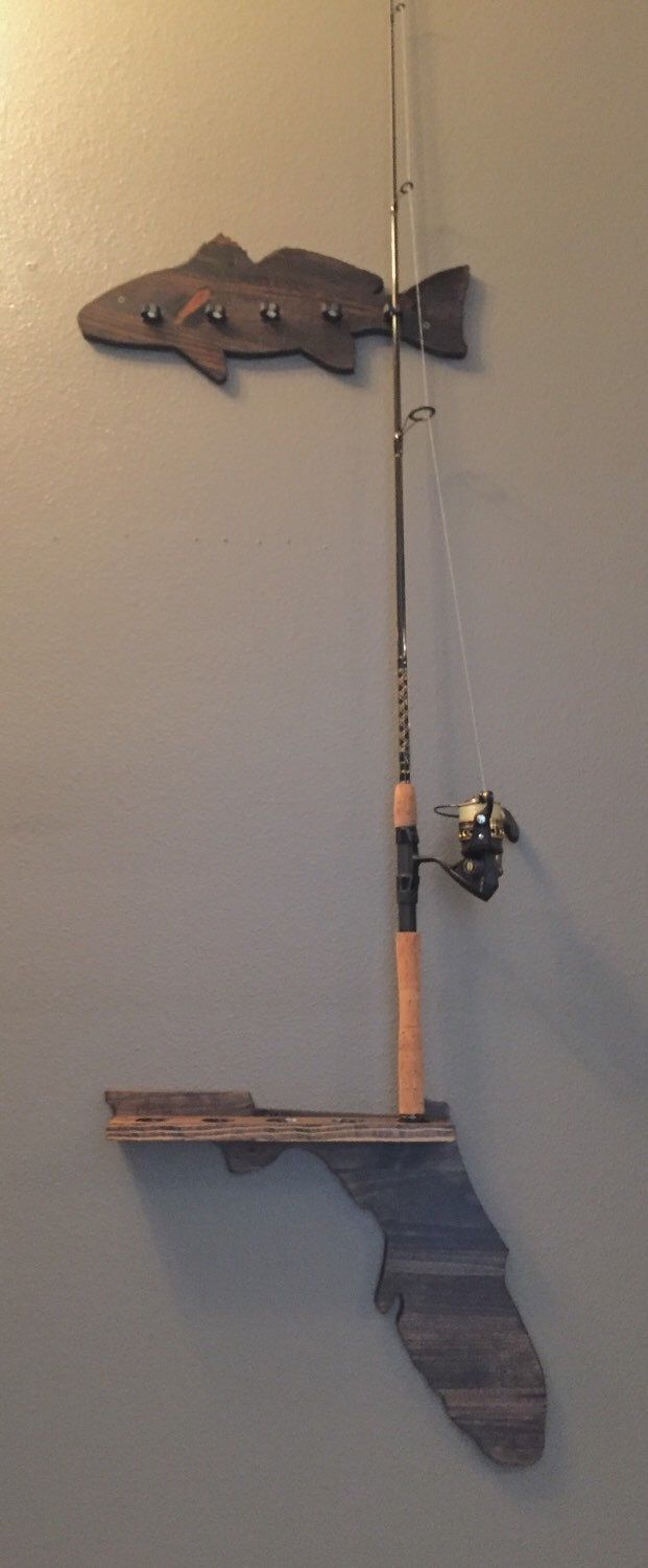 25 best ideas about fishing pole decor on pinterest for Wall fishing rod holder