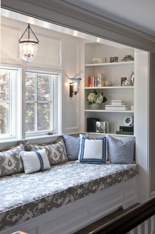 great window seat - and love the lantern. Love the recessed shelving and framed raised areas on walls.