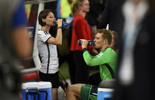 Germany's goalkeeper Neuer and his girlfriend Gilch drink at the end of the 2014 World Cup final against Argentina at the Maracana stadium in Rio de Janeiro