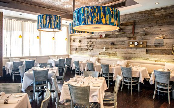 Restaurant interior with blue white taupe color scheme