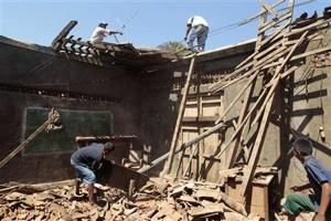 Residents of Nagarote town repair the roof of their… April 12