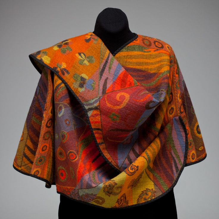 Short Wrap Jacket. Fully reversible.  Many different colors and patterns.