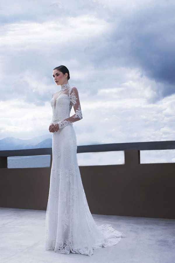 White mermaid with French beaded lace combined with a removable high neck and long sleeved cardigan