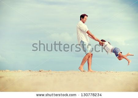 Healthy father and daughter playing together at the beach carefree happy fun smiling lifestyle by Warren Goldswain, via Shutterstock
