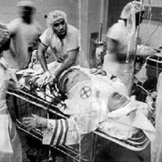 Tolerance breeds tolerance. This picture isn't fake. Black surgeons, doctors and nurses working to save the life of a KKK member.