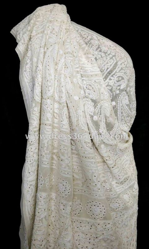 A pure georgette saree with intricate chikankari embroidery and golden Mukaish/ Kamdani.Fabric :Pure Georgette (60gms) Technique: Hand Chikankari Embroidery Wash Care: Hand Wash or dryclean  Since it is a hand crafted product,there can be slight variations in the embroidery. Actual colours may vary slightly from the photograph.