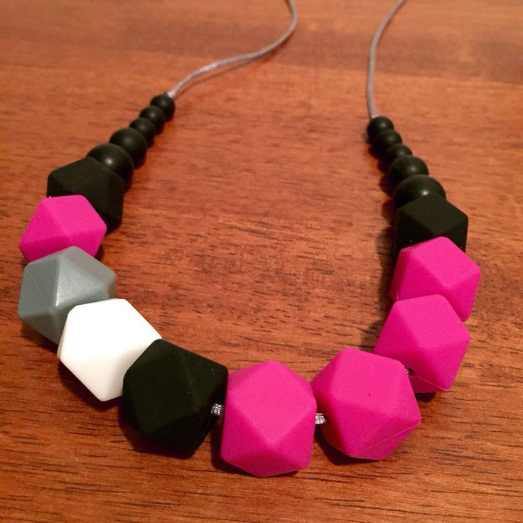 Fussy Little Fox Geo Hexagon Teething Necklace in magenta, black, grey and white on silver nylon cord with black safety catch. $32 + Free Shipping within Australia. Visit Fussy Little Fox on Facebook or email fussylittlefox@gmail.com to order! #fussylittlefox #bpafree #nontoxic #siliconeteethingnecklace #teething #soregums #baby #dribble #mum #fashion #necklace #chew #oralsensory #sensorychew #fussy #fussybaby #handmade #handmadewithlove