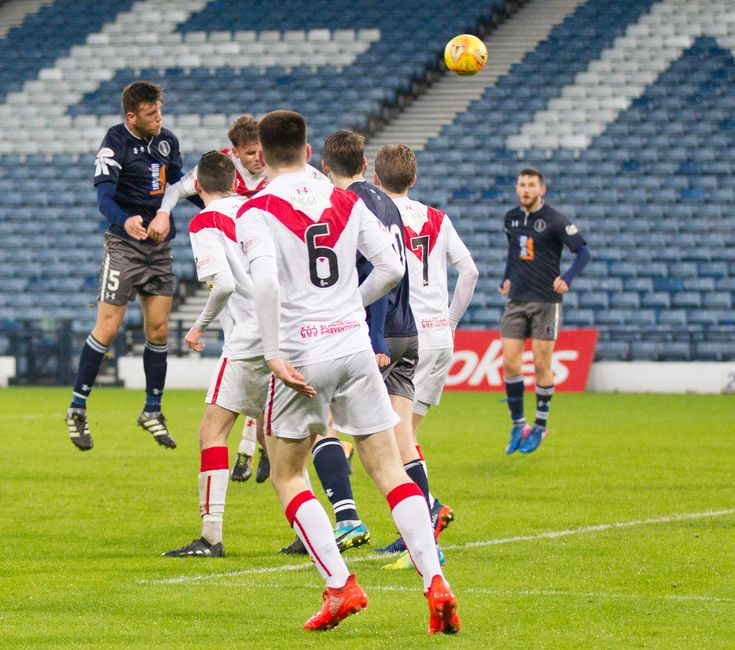 Queen's Park's Adam Cummins heads a goal during the SPFL League One game between Queen's Park and Airdrieonians.