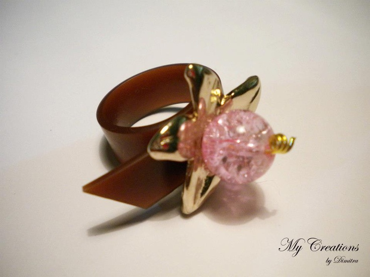 caoutchouc ring (golden flower, bead)
