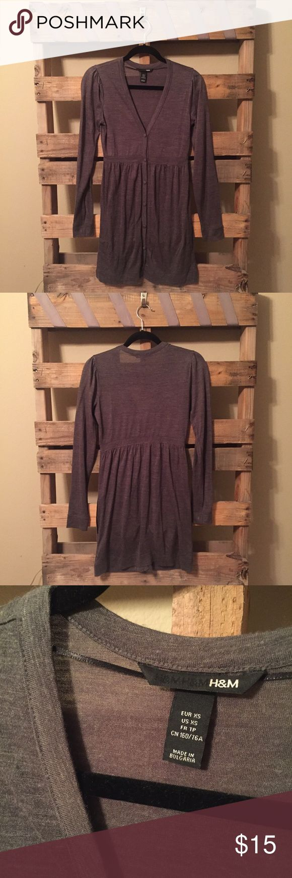 H&M Long Sleeve Dress Grey long sleeve, button front dress.  So flattering and equally comfortable. Can be worn alone during a chilly spring day or pleasant fall. Dress up with tights and a jacket for the winter. Very versatile!  Good used condition.  Size XS but I think it runs a bit closer to a S/M. H&M Dresses Long Sleeve