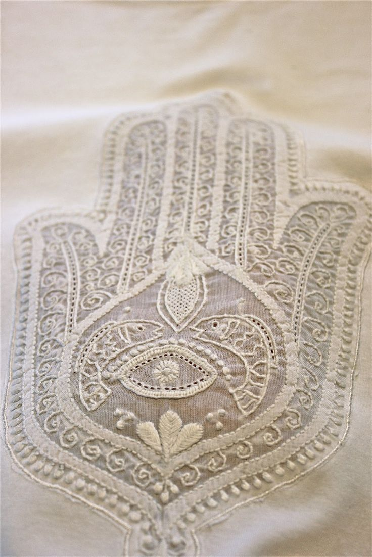 Khamsa hand, embroidered in white. From Aysa store, hand-embroidered in the traditional Chikkankari style by the women of Jais village, in Uttar Pradesh, India.
