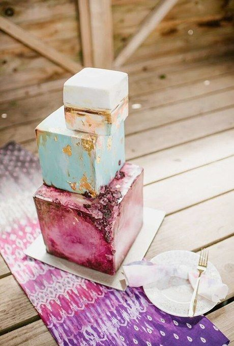 Stacked square-shaped tiers in saturated hues, touches of gold, and a drizzling of edible crystals make up this trifecta of modernity. Created by Nevie-Pie Cakes.