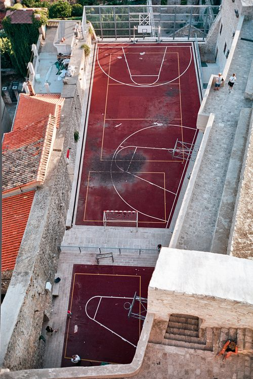 I actually know where this is! This is looking down upon the ancient walls - and modern basketball courts - of the city of #Dubrovnik in Croatia.