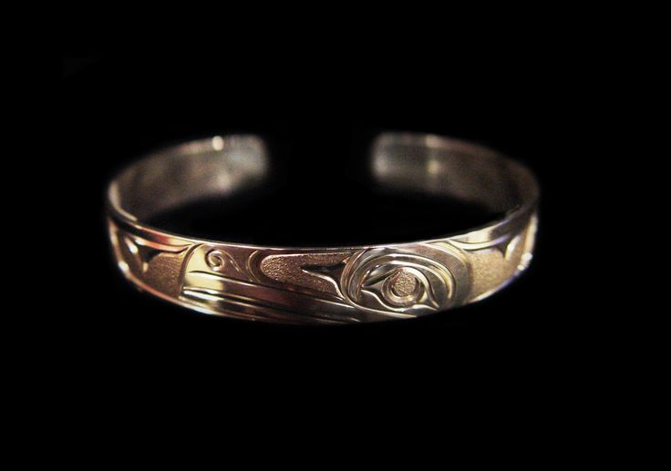 """Raven Bracelet, Joe Descoteaux. Hand carved sterling silver, 0.38"""". Northwest Coast First Nations Jewelry."""