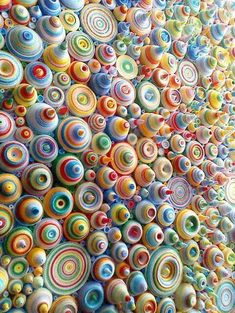 Rolled paper by Karl Stedman Would look pretty cool in a 3d shape too like a large colourful ball maybe? Or an undulating piece of wall work in different colours or just one colour.