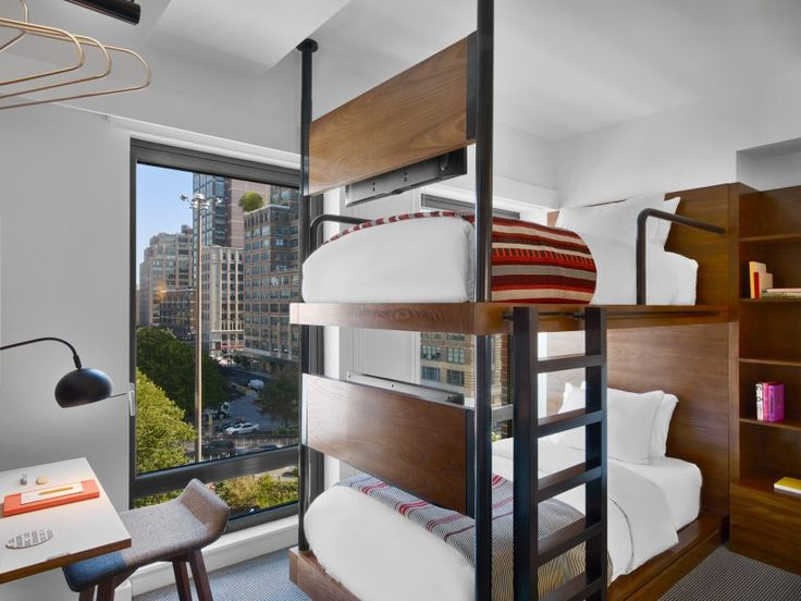 New York studio AvroKO has designed the interiors of Arlo Hudson Square, a new boutique hotel with tiny rooms – some of which have bunk beds