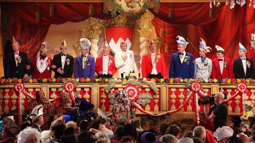 "A typical Fasching event is the ""Prunksitzung,"" which literally translated means pomp session. Amateur comedians hold, in their local dialect, humorous speeches spiced with sarcasm about local happenings, people or politics in general. In between speeches, carnival club members sing and present dances. A committee consisting of a president and 11 counselors watch the session from their seats in the back of the stage. After each performance, committee members present medals to the performers."