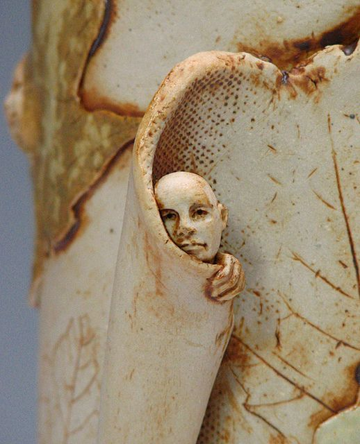 Vase With Tiny Faces - closeup by All That Glissons, via Flickr