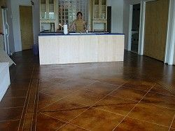 Acid-washed concrete floors!  YES!  (Thanks for the idea, Sarah Lanier)  You can even tape it off to mimic grout lines!