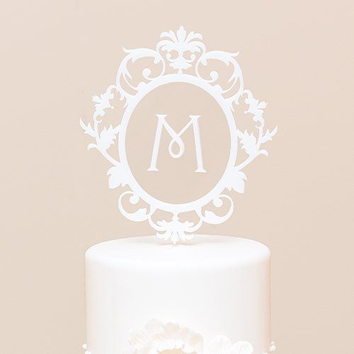This intricate floating monogram cake topper adds instant sophistication to your wedding cake design.