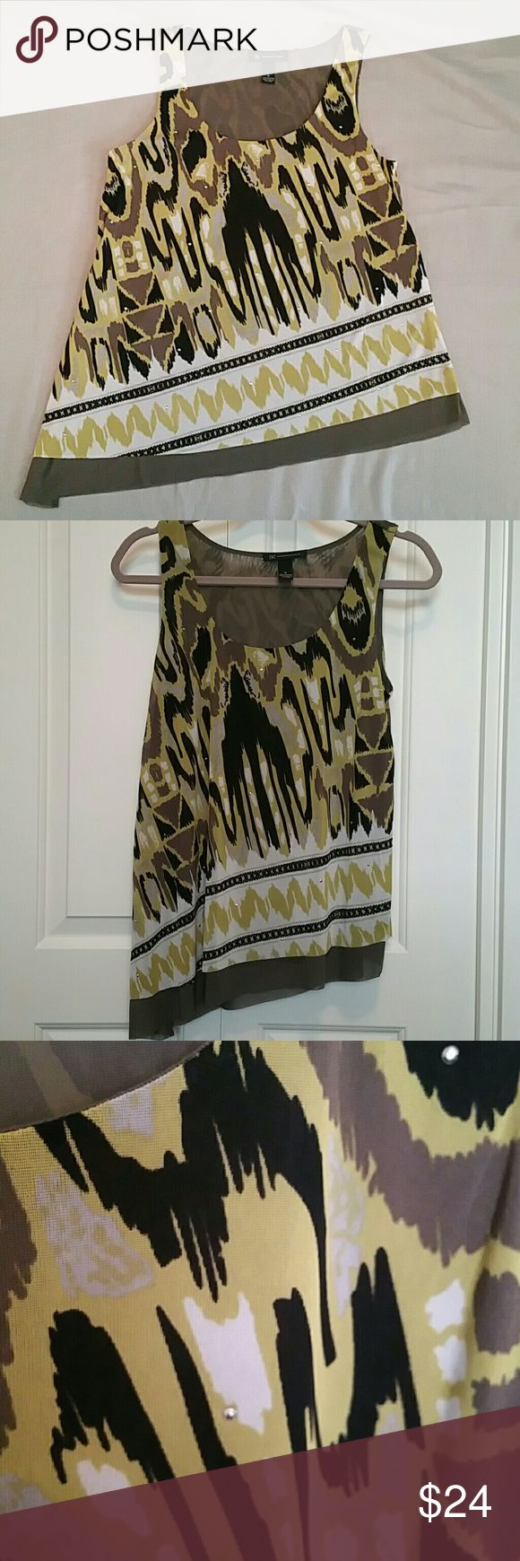 Macy's INC Asymmetrical Tank Size Med I have tried this on but never wore it. It is green / black / white with small Silver studs. 100% Polyester, machine wash cold. It is a loose flowey fit that does not cling. It also has a tier on the bottom (the darker color after the pattern) INC International Concepts Tops Tank Tops