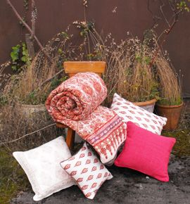 Cosy quilts and cushion covers to mix and match, hand block printed in India by Anokhi for Chandni Chowk
